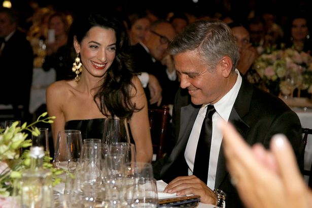 amal and george at the celebrity fight night in florence