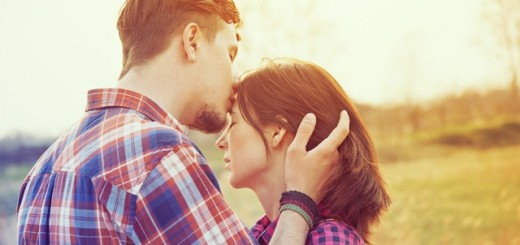 man kissing a woman's forehead_New_Love_Times