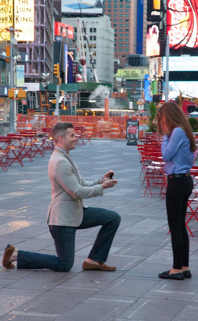 ryan serhant proposing to emilia bechrakis at times square