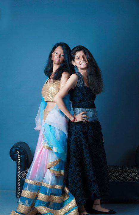 two acid attack survivors pose together