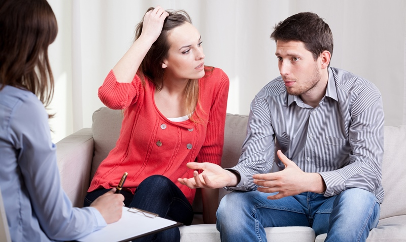 couple talking to a therapist