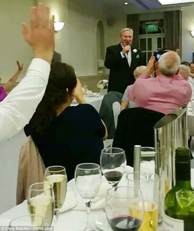 john serenading his surprised daughter at her wedding reception