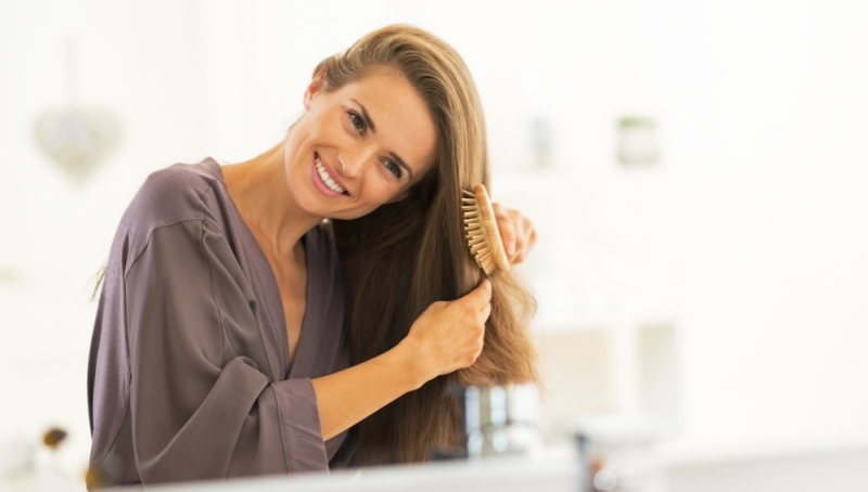 woman brushing hair_New_Love_Times