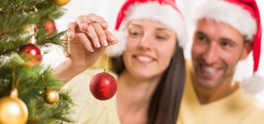 couple decorating a christmas tree_New_Love_Times