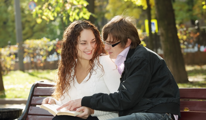 couple reading on a bench