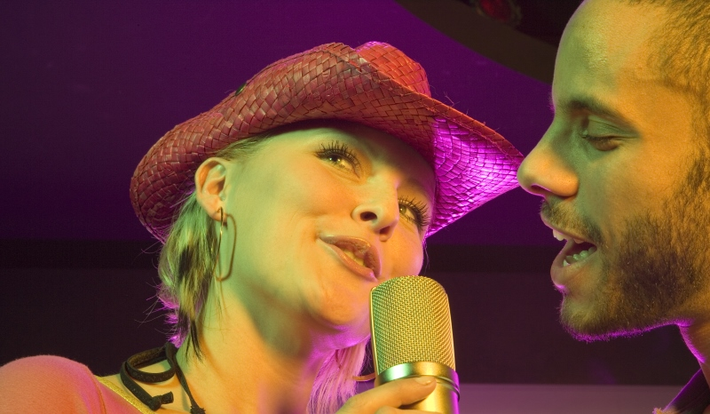 couple singing at a karaoke bar_New_Love_Times