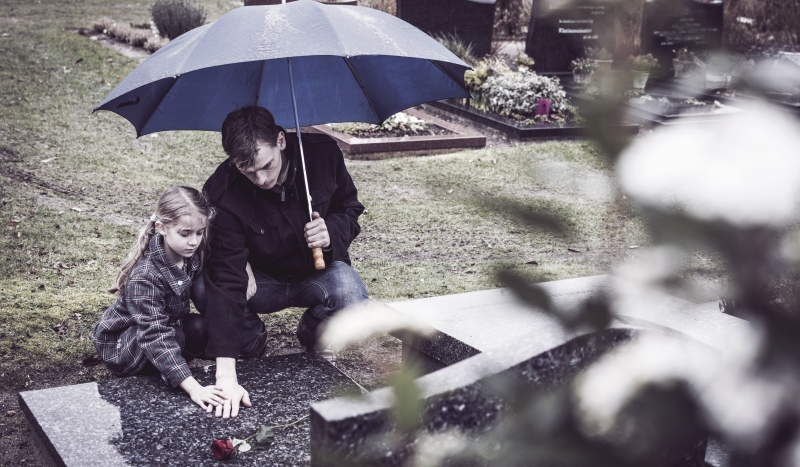 father and daughter visiting a grave_New_Love_Times