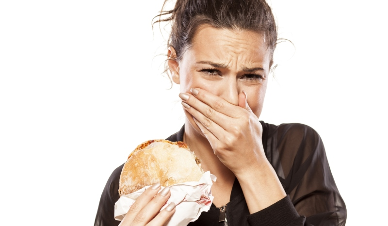 woman making a face while eating