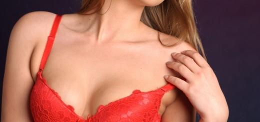 woman taking down her bra strap