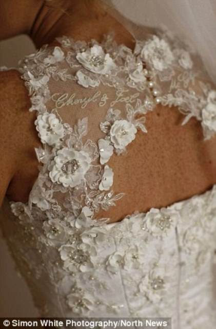 cheryl mcglynn added hers and her husband's names on the back of the dress