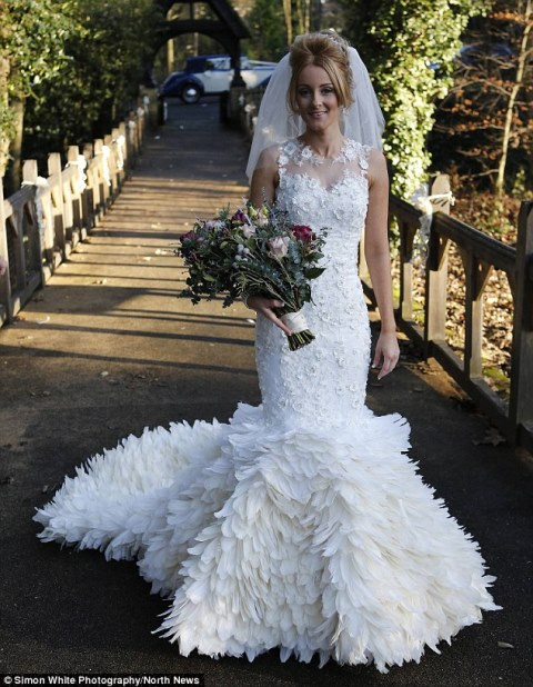 cheryl mcglynn wearing the stunning gown she created by hand-stitching 22,000 goose feathers onto it