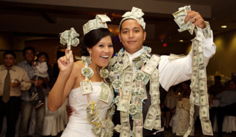 guests pin money to the bride's dress in cuba