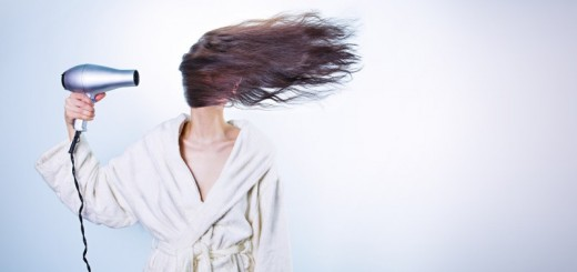 woman blow drying hair_New_Love_Times