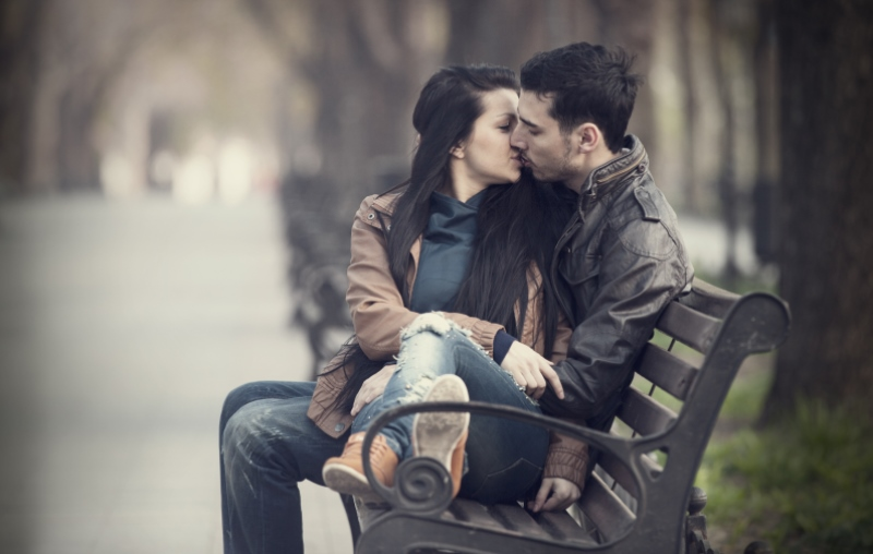 couple cuddling on a bench_New_Love_Times