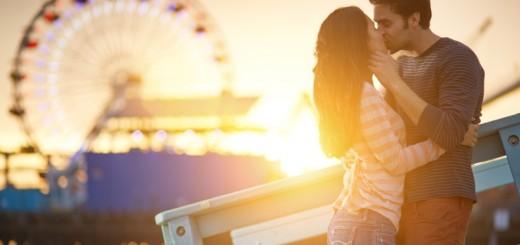 couple kissing at a carnival