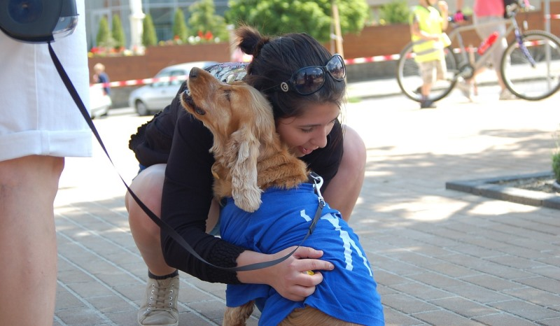 girl hugging a dog_New_Love_Times