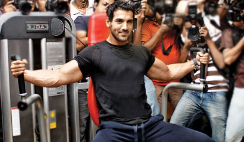 john abraham working out at a promotional event