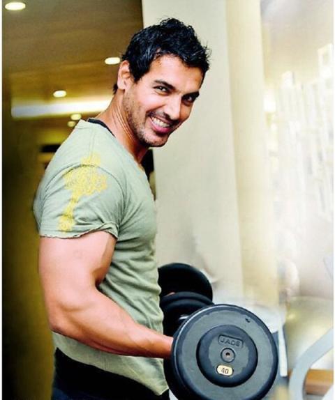 john abraham working out his biceps