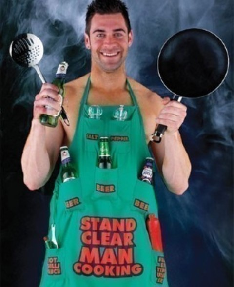 man cooking apron