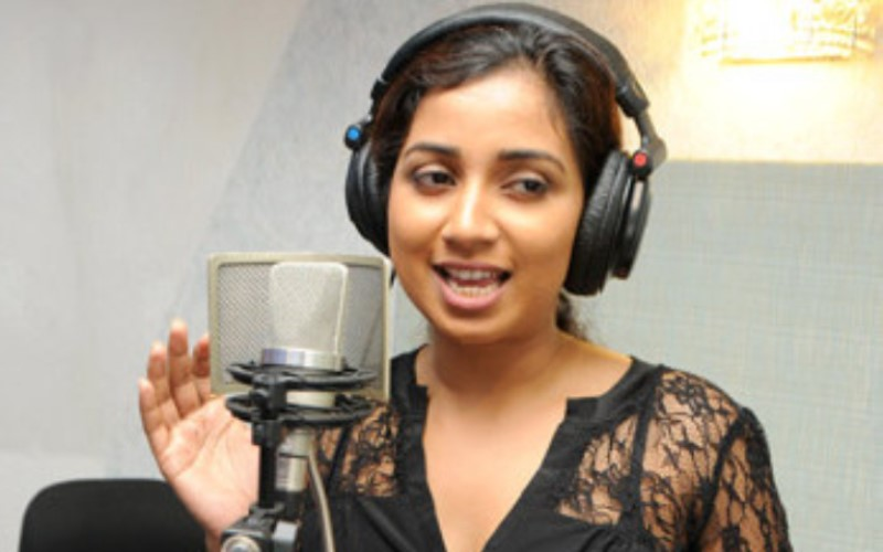 shreya ghoshal recording a song