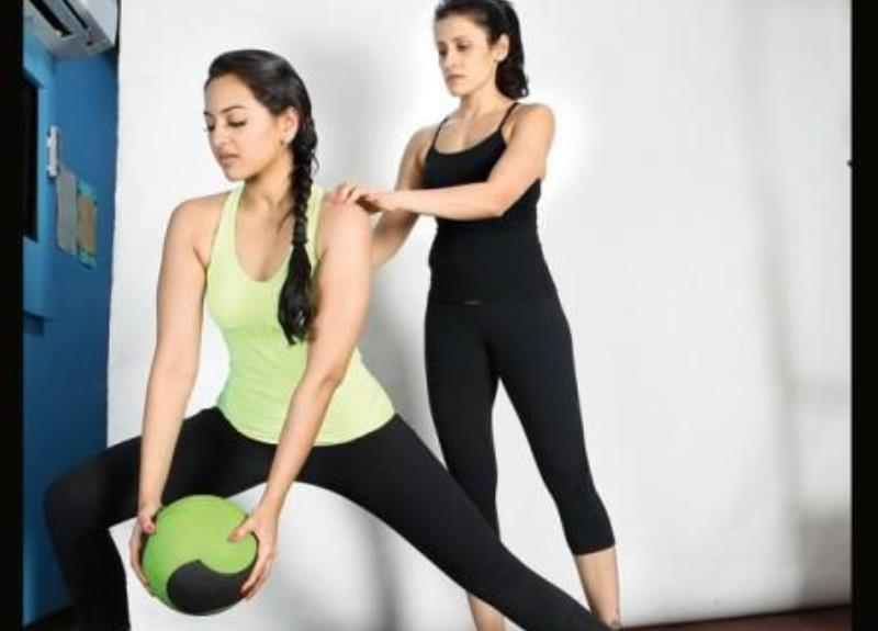 sonakshi sinha working out with a trainer