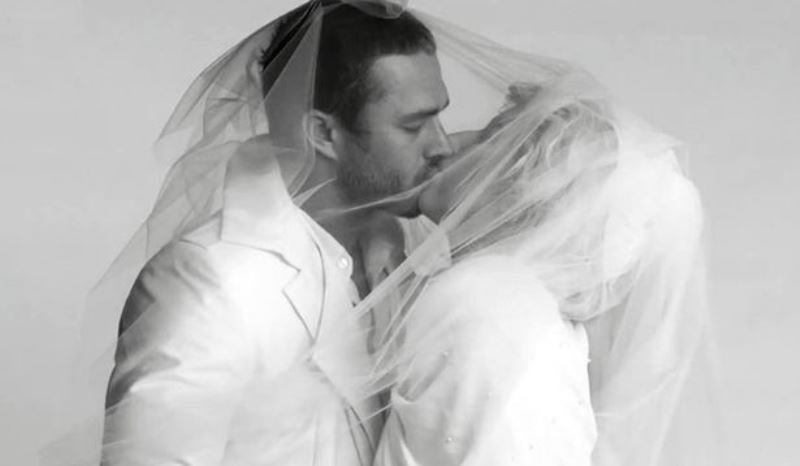 taylor kinney and lady gaga kissing during a video shoot