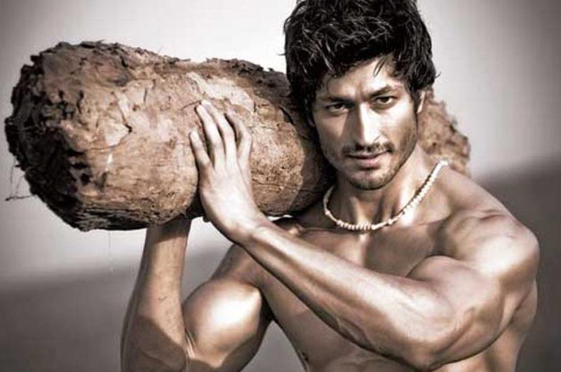 vidyut jamwal hauling a log