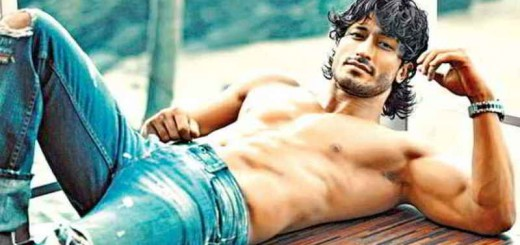 vidyut jamwal lounging and showing off his chiselled abs