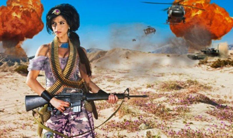 aladdin's jasmine shown as a fierce warrior, carrying a huge gun in a war zone