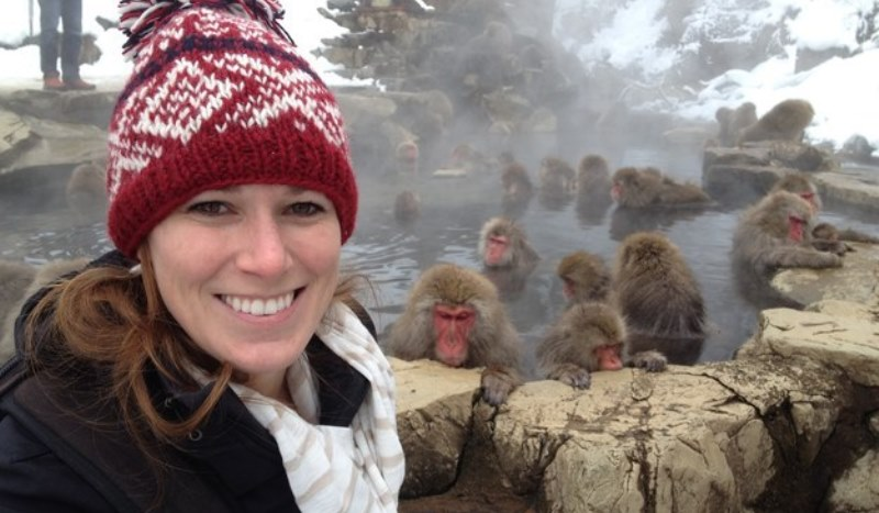 amy with the snow monkeys in the background