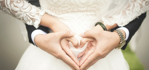 couple forming a heart with their hands_New_Love_Times