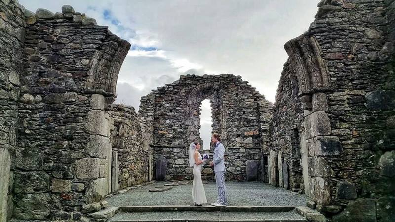 first of the couple's three irish weddings at glendalough cathedral