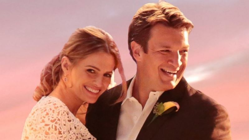 stana katic and nathan fillion during their on-screen wedding