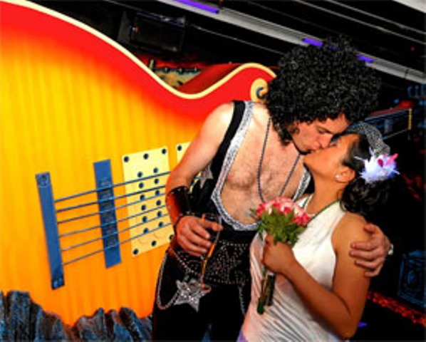 a newlywed couple at the KISS monster mini golf