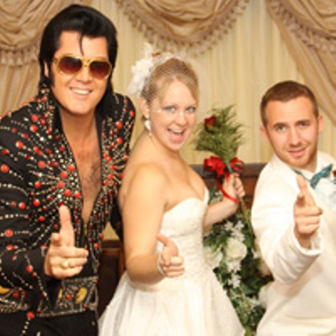 a newlywed couple with an elvis impersonator