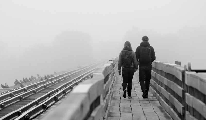 couple walking on a boardwalk