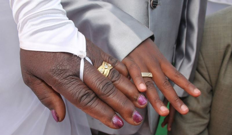 helen and sanele showing off their wedding rings