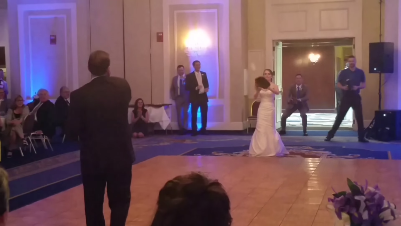 jim and kandice playing catch on the dance floor