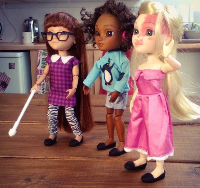 Makies dolls- with a walking cane, hearing aid and a birth mark (l-r)
