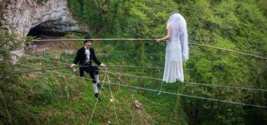 phoebe baker making her way towards her groom chris bull, on a high wire
