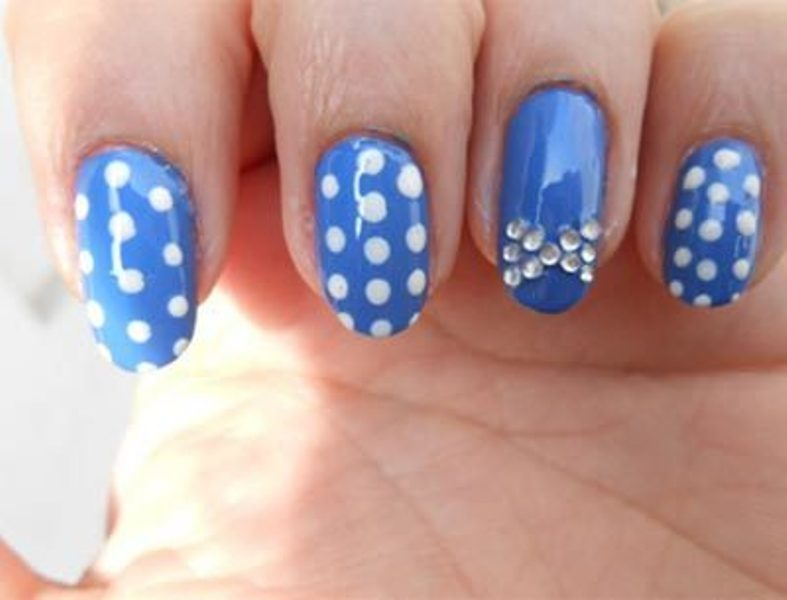 Polka dot and bow nails