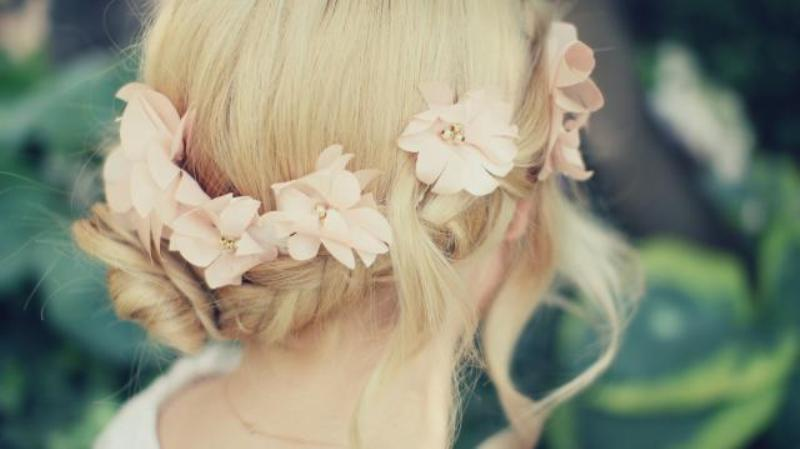 Romantic flowered and braided bun