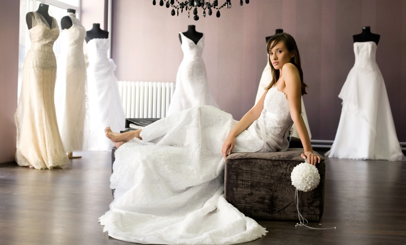 bride in a wedding dress boutique_New_Love_Times
