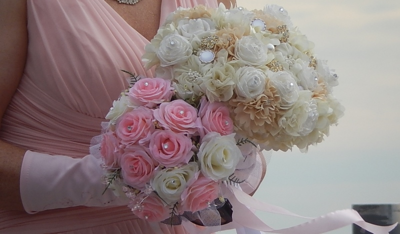 woman carrying wedding bouquet