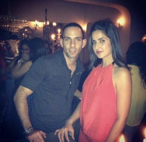 Katrina and Reza at a party