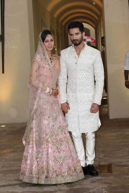 Shahid Mira posing for the press after wedding