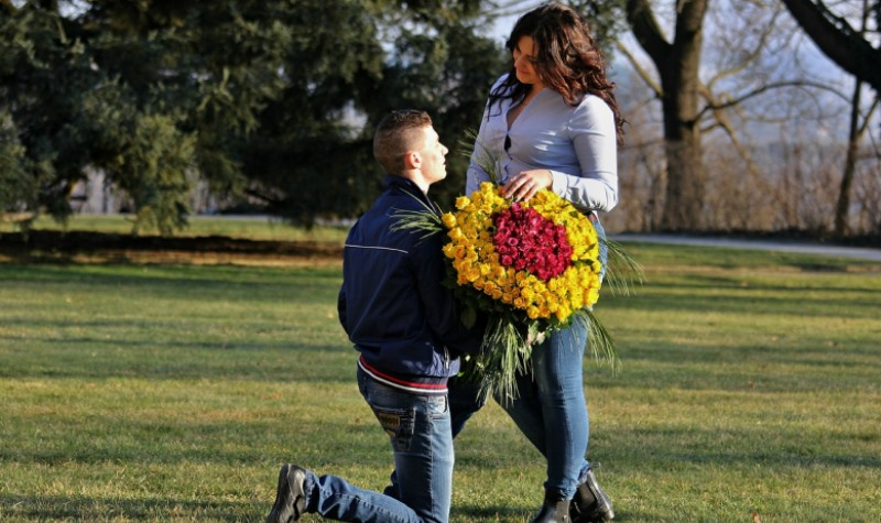 man giving flowers to woman
