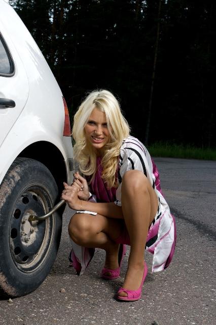 woman changing flat tire