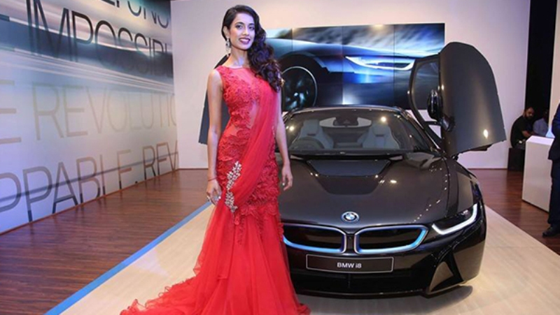 Sarah jane Dias looking stunning in red with the black beauty BMW