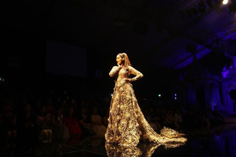 Sonam in a gold-black gown opening the BMW India Bridal fashion Week 2015